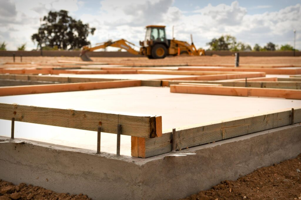 a concrete foundation under working