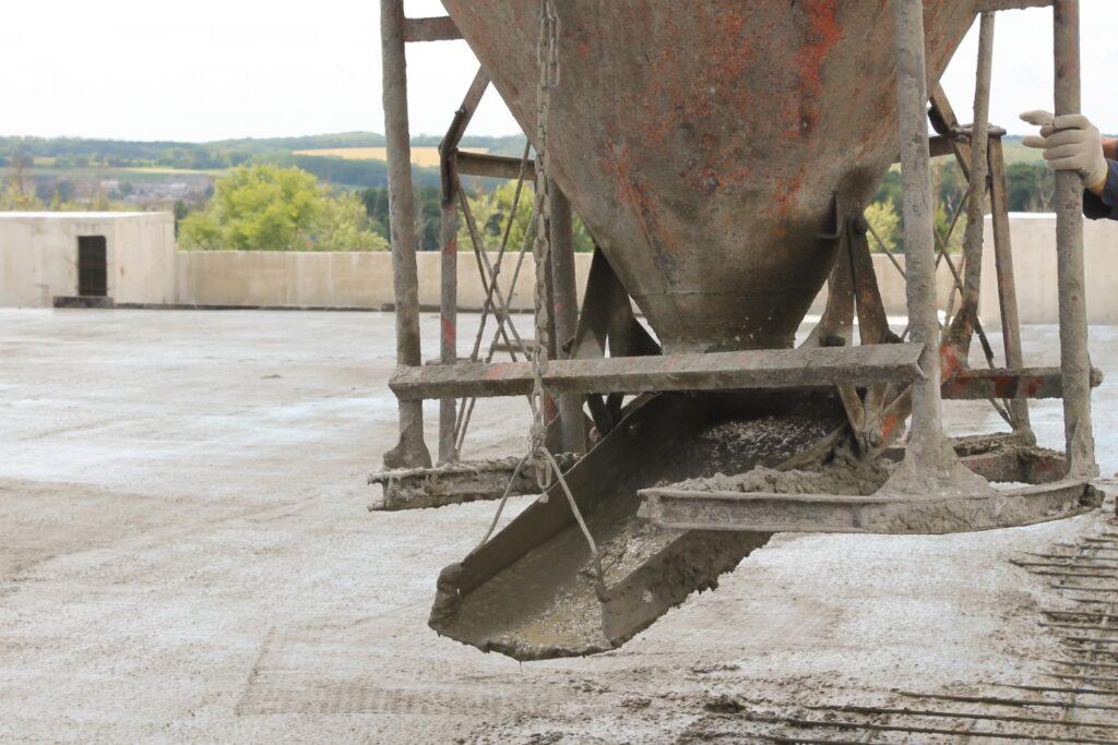 concrete mixer truck pouring fresh cement